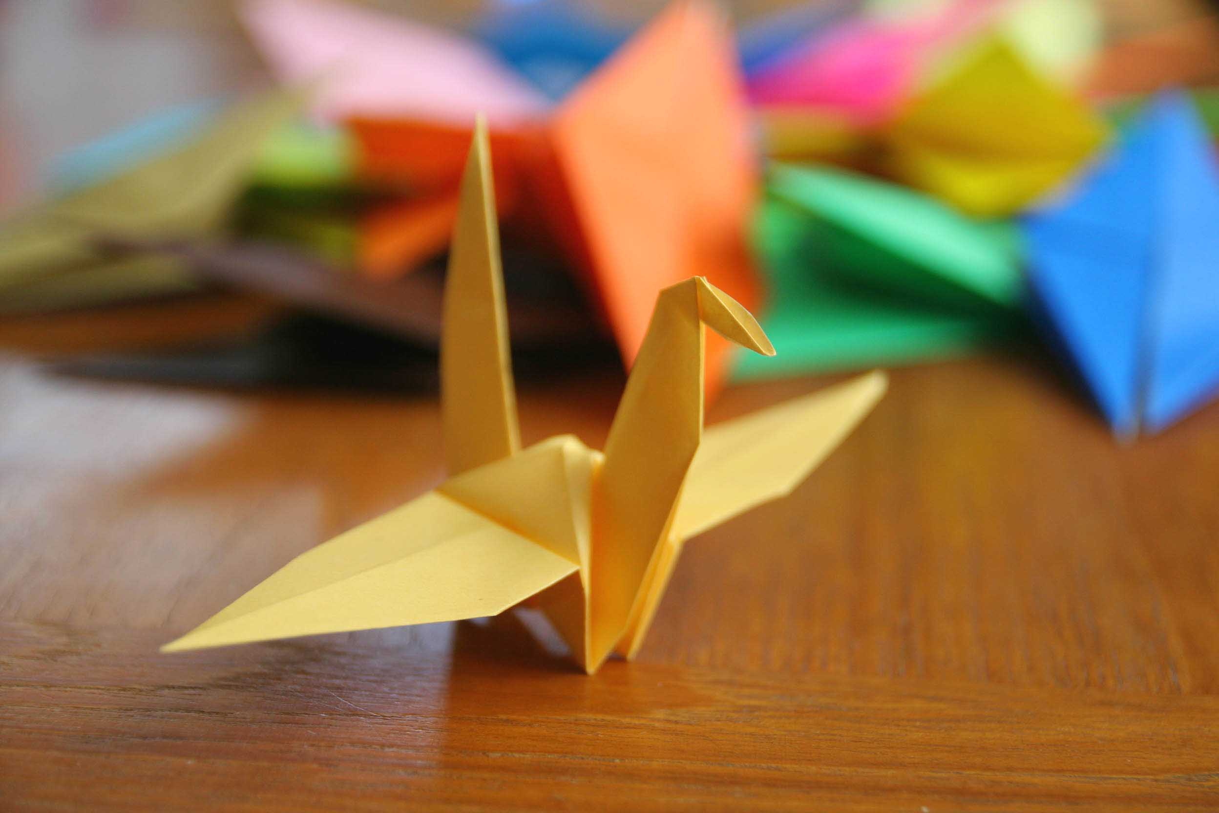 paper crane meaning Tattoos of the paper crane have been growing popular, not only for the symbolism, but because it is a really cool concept of being able to take a simple piece of paper and turning it into something beautiful just by making a couple folds.