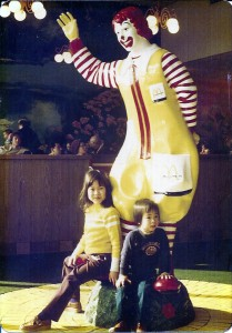 Asian kids with Ronald McDonald statue