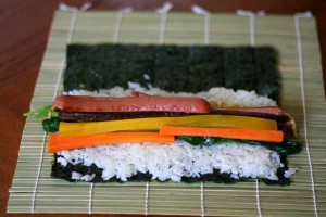 Hot dogs and vegetables on sushi rice