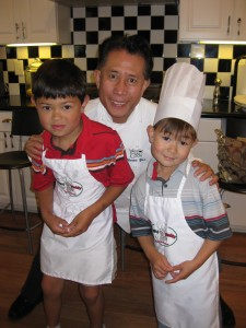 Martin Yan with two of his youngest apprentices.