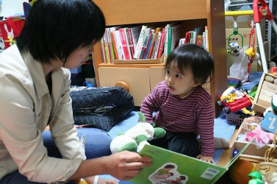 Asian mother and baby reading